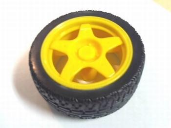 Wiel 65mm diameter geel voor ovaalvormige as 4mm x 5,5mm